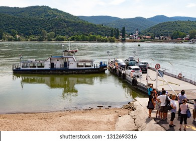 Nagymaros / Hungary - July 24 2018: People waiting to enter the ferryboat to Visegrád across the Danube River