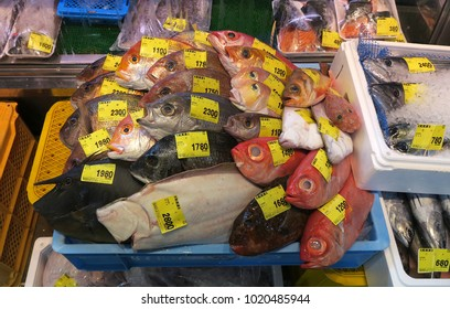 NAHA, OKINAWA, JAPAN - February 3 : Fish in seafood shop in Tomari Fish Market in Naha city, Okinawa taken February 3, 2018. This market is popular among local people and tourists for cheap seafood.