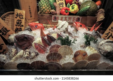 Naha, Okinawa, Japan - February 3, 2018 : Fresh seafood display in restaurant of Kokusai Dori shopping street.