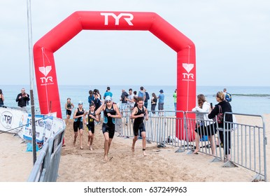 Nahariyya, Israel - May 06, 2017 : Participants of the annual triathlon finish in the swim in the Mediterranean Sea in Ahziv, near the town of Nahariya