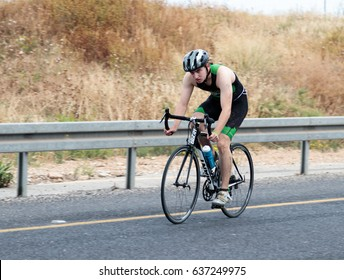 Nahariyya, Israel - May 06, 2017 : Participant of the annual triathlon competes in cycling on the route in Ahziv, near Nahariyya, Israel