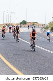 Nahariyya, Israel - May 06, 2017 : Participants of the annual triathlon competes in cycling on the route in Ahziv, near Nahariyya, Israel