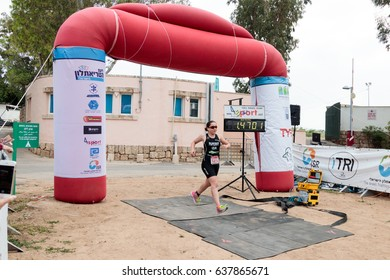 Nahariyya, Israel - May 06, 2017 : Participant of the annual triathlon finishes in the race in Ahziv, near the town of Nahariya