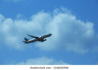 Naha-shi/Japan - January 22 2016: Jetstar airways plane take off in airport in naha. Jetstar Airways Pty Ltd, trading as Jetstar, is an Australian low-cost airline headquartered in Melbourne