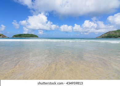 Naihan beach on beautiful day with blue sky and could background.