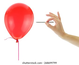 Nail about to pop a balloon isolated on white