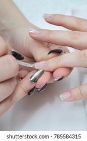 Nail art building nails drawing nails close up in beauty salon