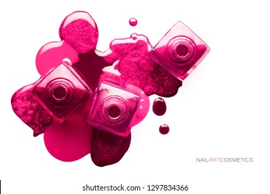 Nail art concept. Fine art cosmetics and beauty image with different shades of metallic pink nail polish artistically spilled around three bottles. Top view isolated on white with copy space for text