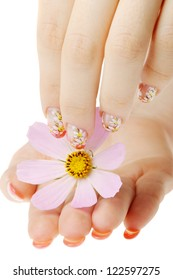 Nail art. Female nails with figure of a camomile close up above a flower