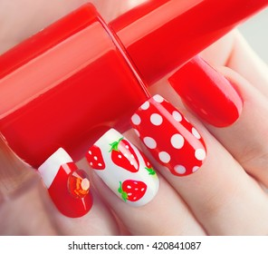 Nail art manicure. Summer bright Manicure with painted strawberries and polka dots. Bottle of Nail Polish. Beauty salon. Hand. Trendy Stylish Colorful Nails, Nailpolish