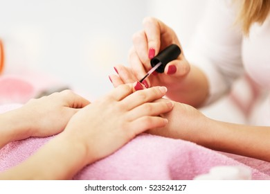 Nail care in salon. Selective focus on costumer's nails.