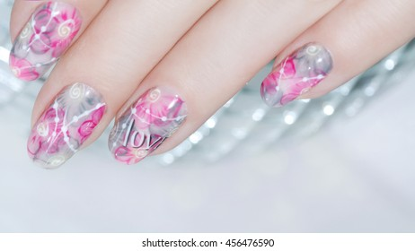 Nail design . Manicure nail paint . beautiful female hand with colorful nail art design manicure