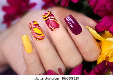 Nail design on shiny and matte nail Polish with smooth curves.Fashionable multicolored manicure. - Shutterstock ID 1866609220