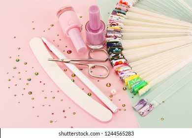 Nail designs on tips and manicure set on a colored background.