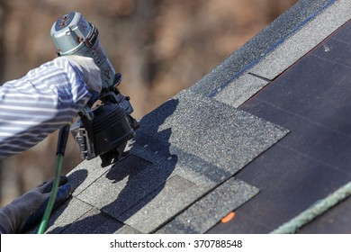 The nail gun is used to attach shingles to the roof.