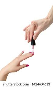 Nail laquering process. Woman hands.