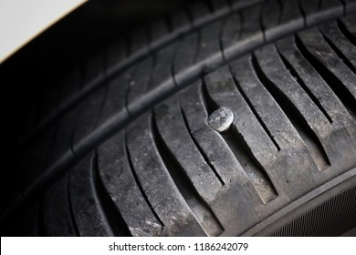 nail on the old flat tire