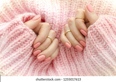 Nail Polish. Art Manicure. Modern style pink Nail Polish.Stylish pastel Color pink Nails holding wool material sleeve blouse . Classic wedding bride nails design