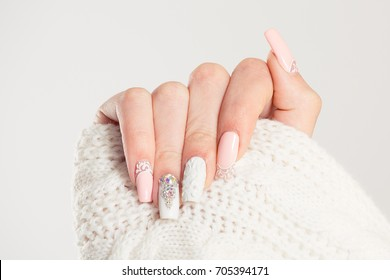 Nail Polish. Art Manicure. Modern style blue Nail Polish.Stylish pastel Color pink white Nails holding wool material sleeve blouse isolated white background wall. Classic wedding bride nails design