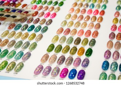 Nail Polish Color Charts. Nail polish swatches in different fashion color. Colorful nail lacquer in tips. Shiny gel lacquer