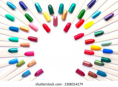 Nail polish colorful samples in rainbow colors. Set of artificial nails. Top view, copy space for text