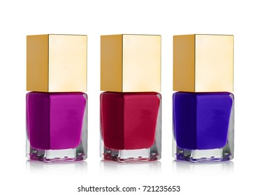 Nail polish cosmetic bottles with golden top different colors on white background