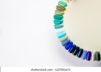 Nail polish in different fashion color. Colorful cats eye 3D nail lacquer in tips and mock-up blank bottle isolated white background.Shiny gel lacquer. feminine nail art.Nail art design .