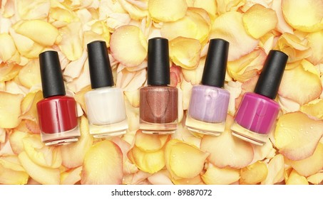Nail polish in rose petals - beauty background