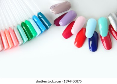 Nail polish samples in different bright colors. Colorful nail lacquer manicure swatches. Top view of nail art wheel palette.