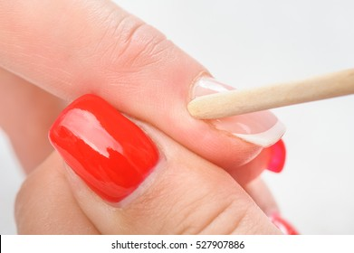 Nail salon, hands beauty treatment, cuticles care with bamboo wood cuticle pusher