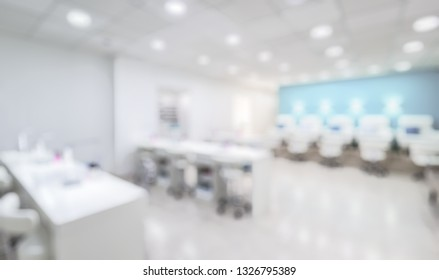 Nail salon interior as creative abstract blur background. Panoramic view of a modern manicure salon. Inside a beauty studio with white and blue design. Spacious bright spa room.