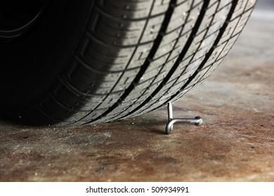 the nail twist pierced  the passenger tire