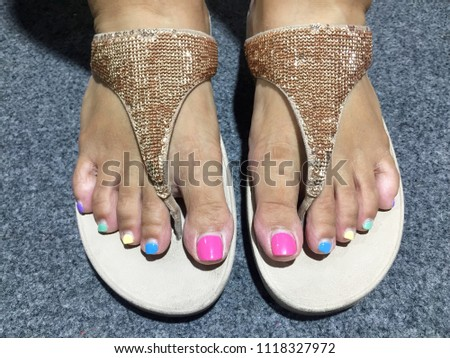 47a4349389cf Pedicure with different colors of paint on a woman s feet. Female feet with  pink