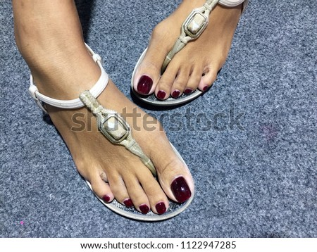 c9ccd950c5ae Nails art.Pedicure design nails burgundy. Feet with long manicured nails  colored with dark