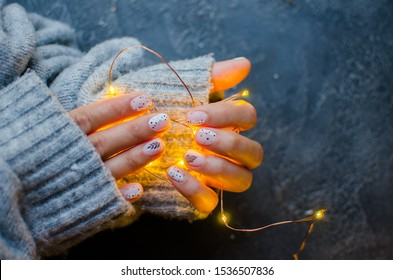 nails with christmas lights. Place for text. Cozy winter nails.