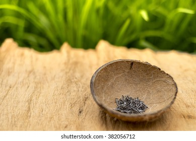 Nails in the coconut bowl with natural background