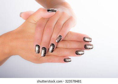 nails decorated with neutral colors
