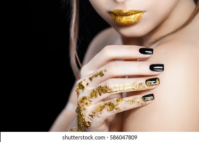 Nails design, Gold lips, Fashion beauty. Glamour girl with bright makeup. Beauty female. Perfect skin and make up. Nail polish. Isolated on black
