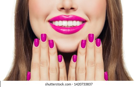 Nails and lips. Woman touching her cheeks her hands with manicure nails. Pink color lipstick and nail polish