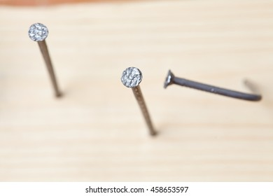 nails on the wood panel