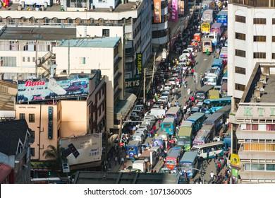 Nairobi, Kenya - December 23: Work and Christmas traffic with Matatus during rush hour on Ronald Ngala Street in Nairobi, Kenya on December 23, 2015