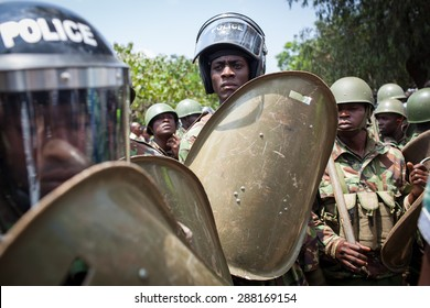 Nairobi, Kenya - February 13, 2014: Color picture of a policemen holding shields