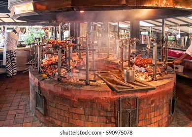 NAIROBI/ KENYA - JANUARY 17, 2008: Carnivore restaurant kitchen with meat on skewers in central grill oven on January 5, 2008 in Nairobi.