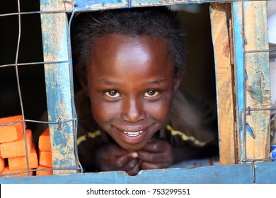 NAIROBI - KENYA - January 2, 2015: Unidentified girl in a small shop in a slum on January 2, 2015 in Nairobi, Kenya