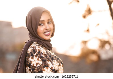 Nairobi, Kenya -July 14 2019: A beautiful muslim girl in a Hijab smiling outdoors