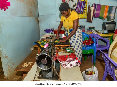 Nairobi, Kenya- March 5, 2016:  Woman Tailor sewing clothes with vintage sewing machine