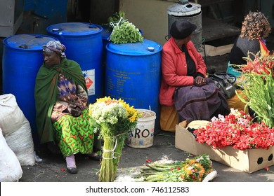 Nairobi - Kenya - October, 2013 : Group of local women selling flowers at the streets of Nairobi.