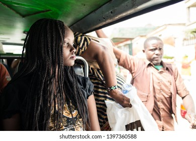 Nairobi / Kenya - September 17, 2013: A young Kenyan woman seats in a matatu (minivans used for public transportation) in the capital of Kenya