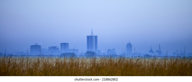 nairobi skyline before dawn partially obscured by fog