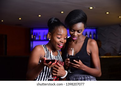 Nairobi/Kenya -Jan 15th 2018: Happy African Model using a smart phone in Kenya